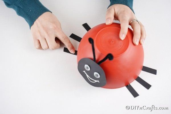 Gluing legs onto ladybug bowl