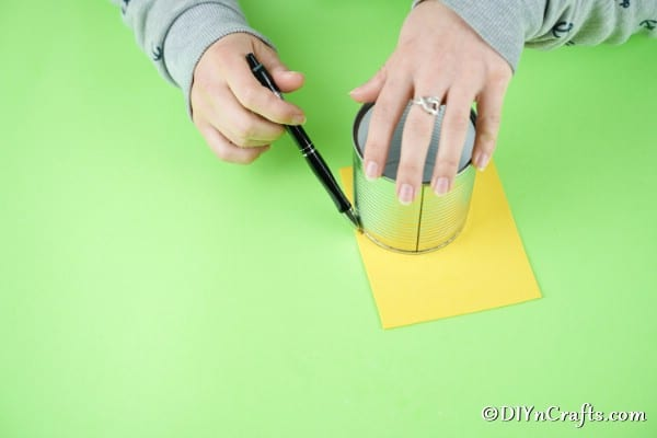 Tracing circle on yellow paper