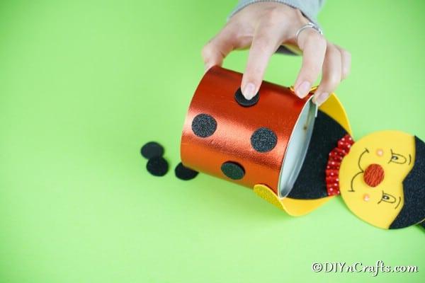 Gluing dots onto ladybug
