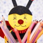 Pencils in tin can ladybug