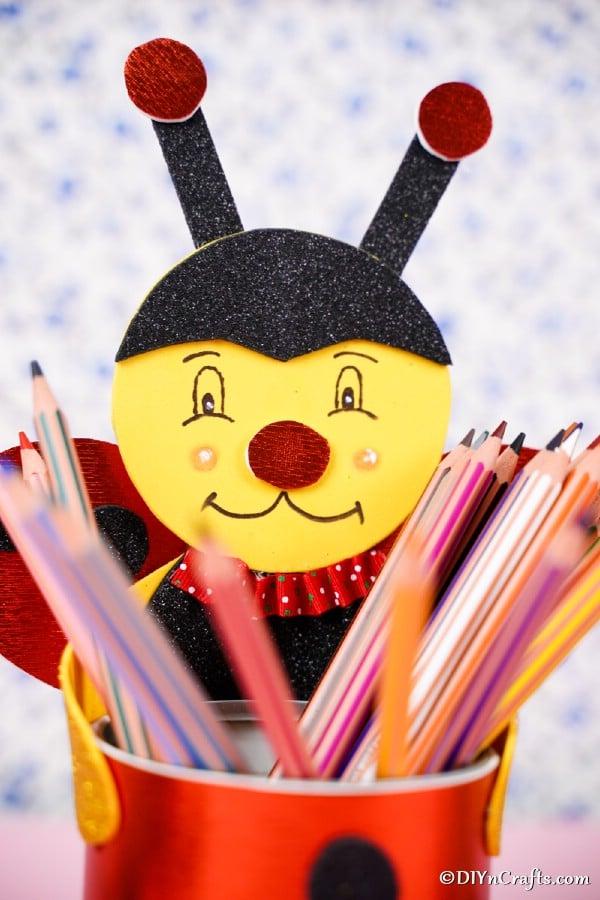 Pencils in tin can ladybug