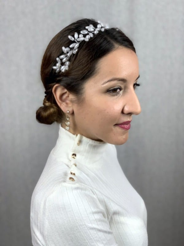 Brown hair in low braided bun with bead accents