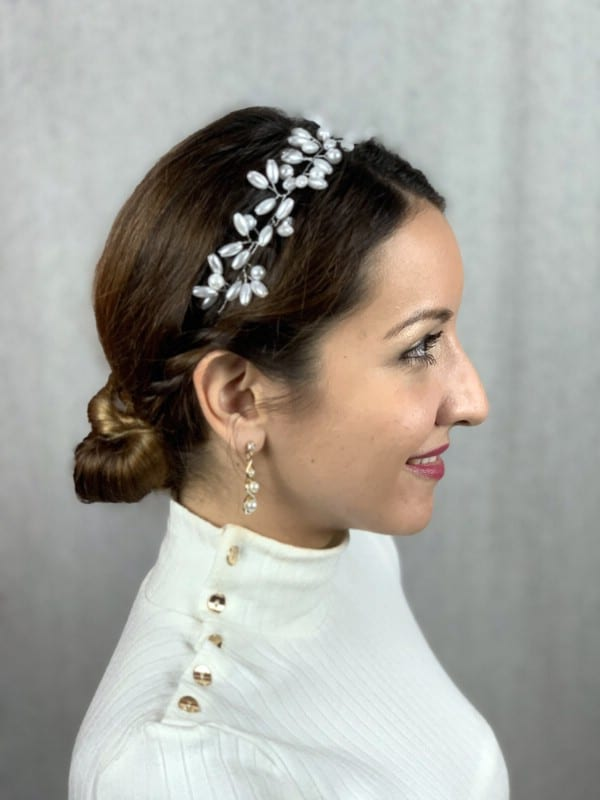 Side view of braided low bun