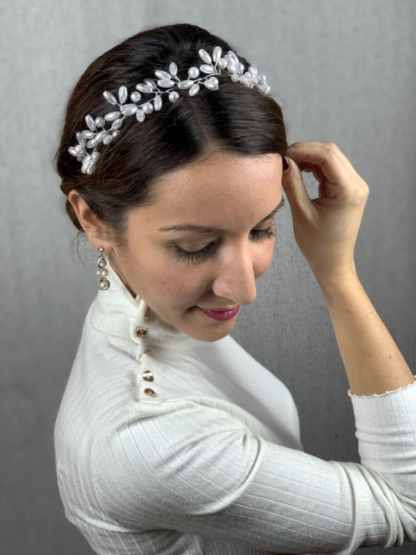 Brunette with braided hair featuring beads