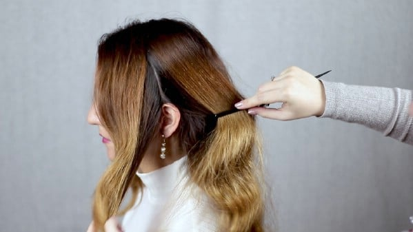 Parting hair before braiding