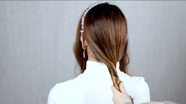 Gathering hair for low ponytail