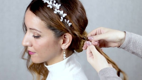 Braiding front of hair.