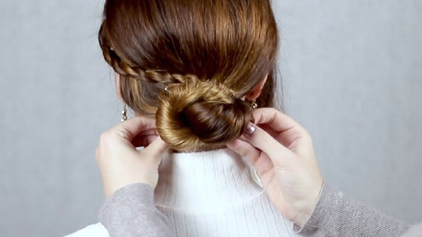Looping braid around the bun