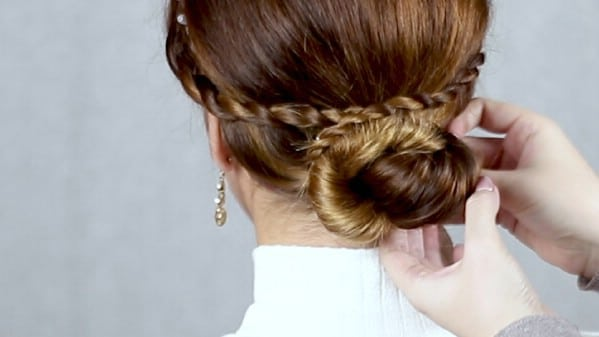 Securing braids around bun