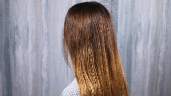 Brushing long brunette hair
