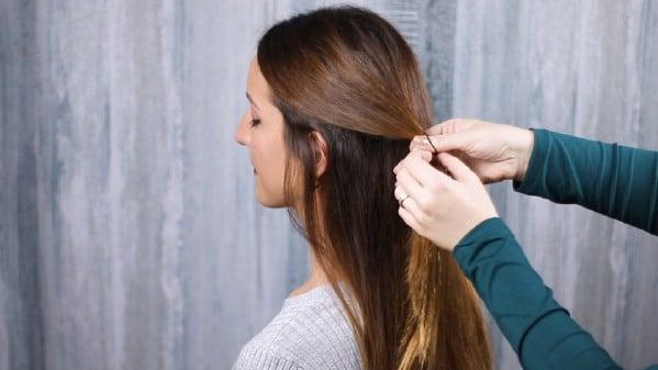 Gathering hair back for low bun