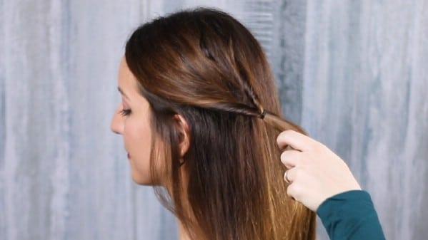 Hair pulled through ponytail