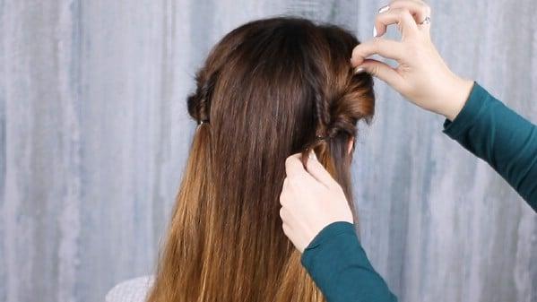 Pulling hair through ponytail