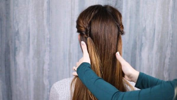 Pulling hair back over shoulders
