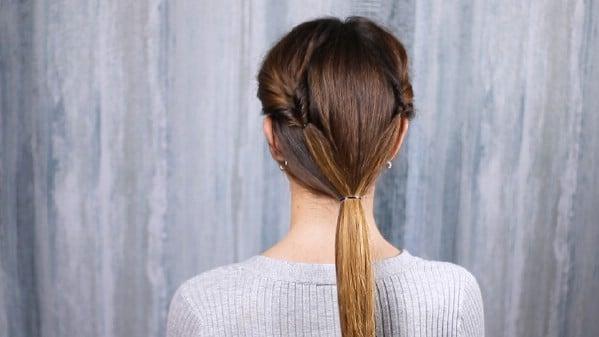 Hair in low ponytail