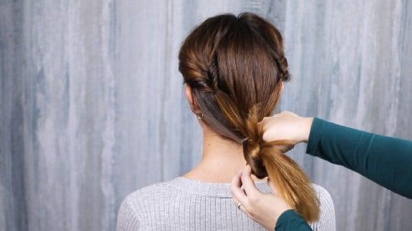 Pulling hair through low ponytail