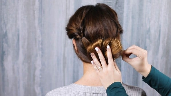 Securing hair in place with bobby pins