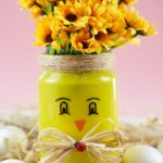 Mason jar chicken filled with yellow flowers