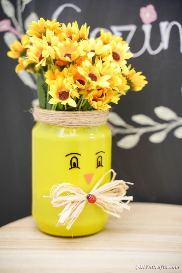 Yellow mason jar vase by chalkboard