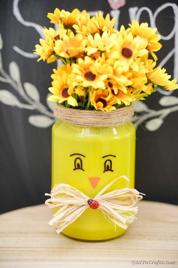 Mason jar chicken vase in front of chalkboard