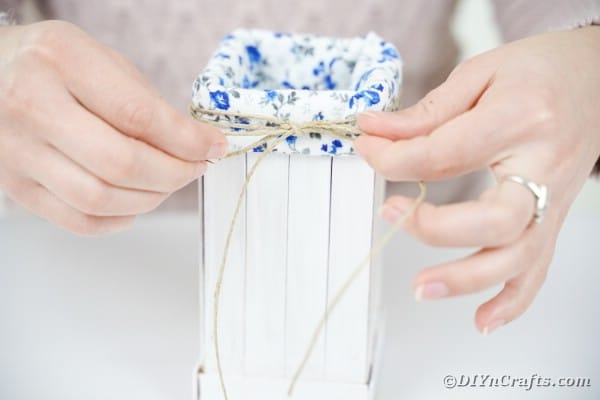 Adding a twine bow to front of organizer