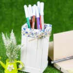 Markers in organizer on grass