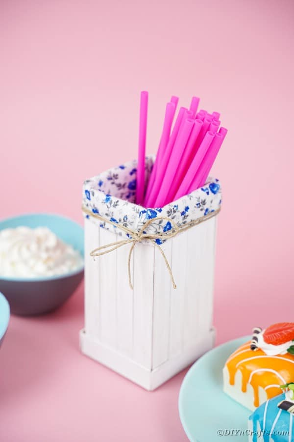 Milk carton organizer on pink background