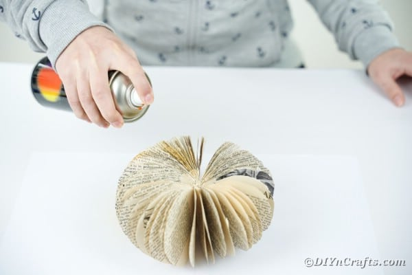 Spray painting pumpkin