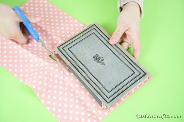 Gluing fabric onto inside of book