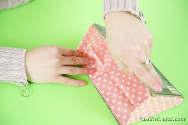 Gluing fabric inside purse