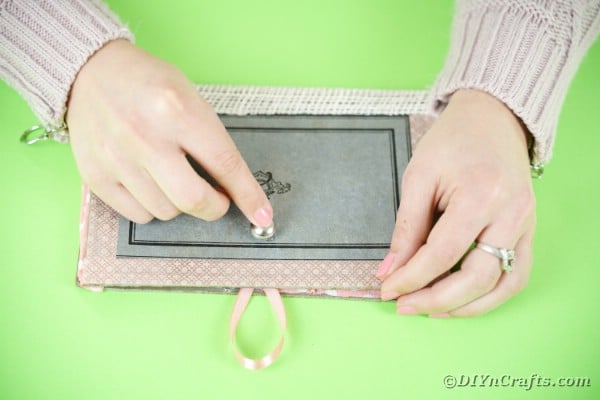 Adding button onto purse