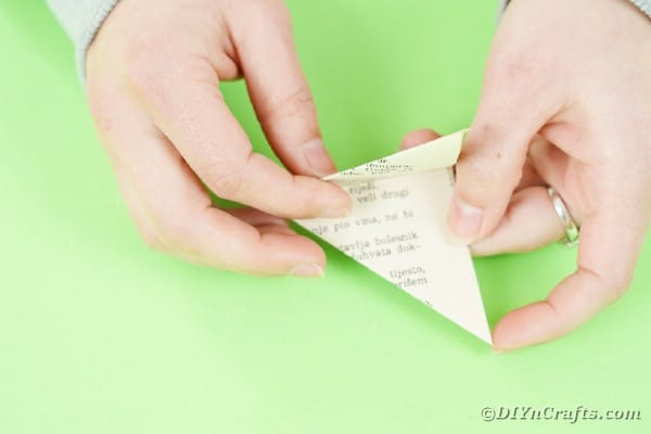 Holding paper triangle