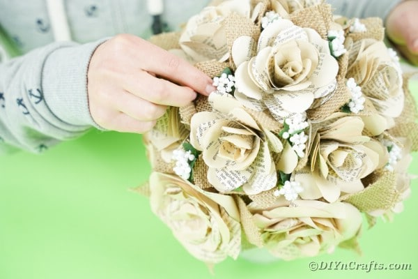 Gluing artificial flowers to flower bouquet