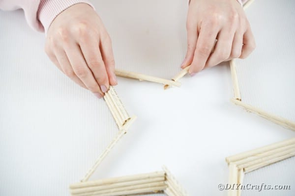 Gluing rolls of paper on top of each other