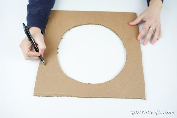 Tracing a wreath on cardboard