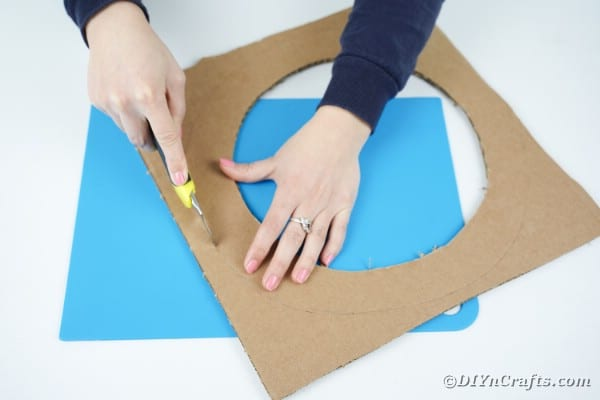 Cutting out a cardboard wreath