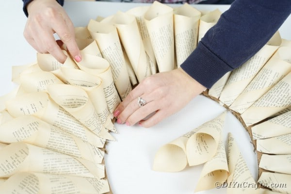 Adding smaller paper cones to ends of wreath