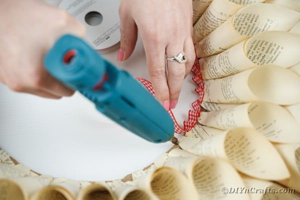 Gluing ribbon onto center of wreath