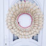 Book page cone wreath on door