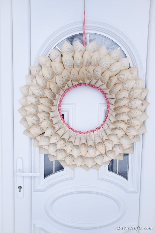 Book page cone wreath on door