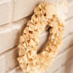 Origami paper wreath on brick wal
