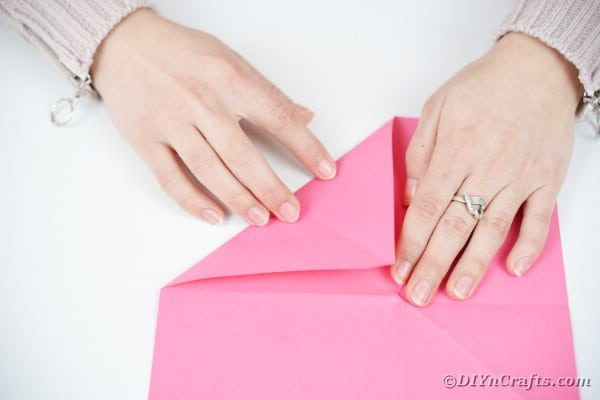Folding edge of pink paper