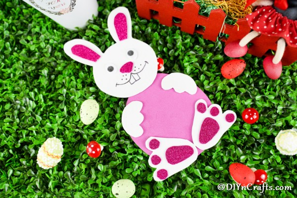Foam paper Easter bunny laying on grass