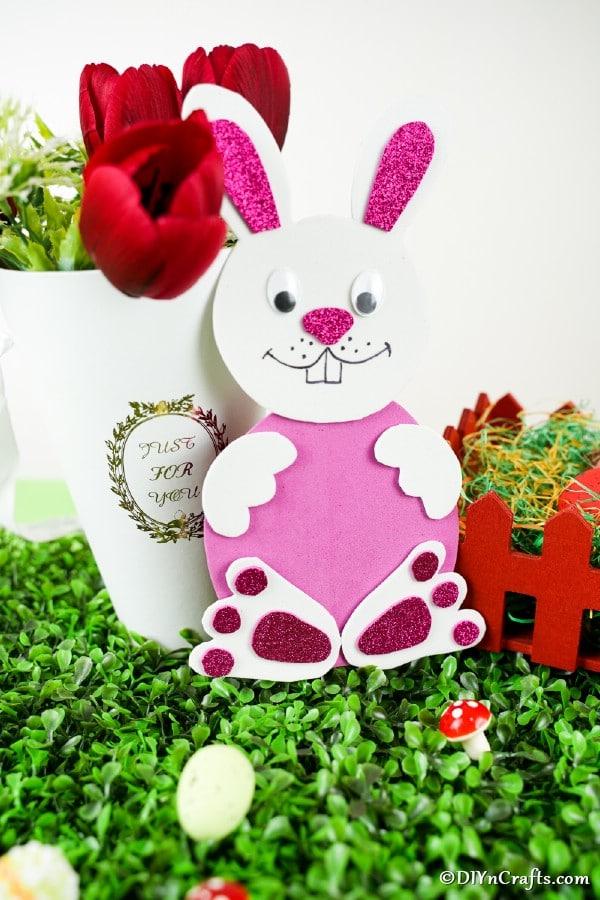 Easter bunny craft leaned against vase