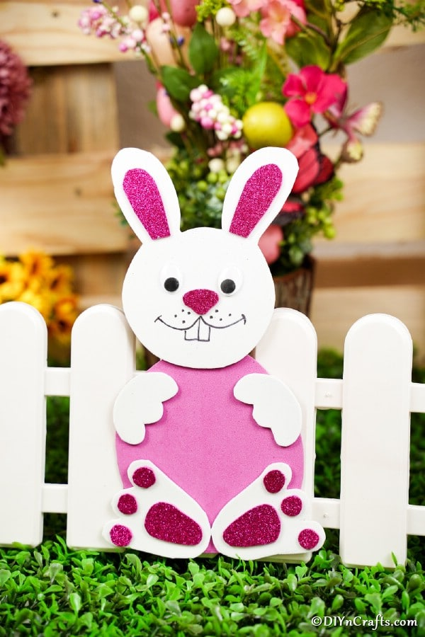 Pink and white foam bunny by mini white fence