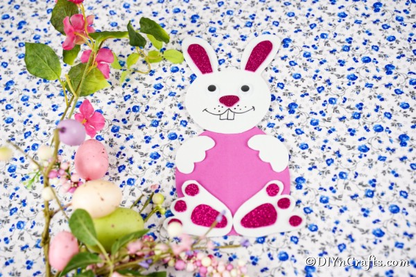 Paper Easter bunny on floral background