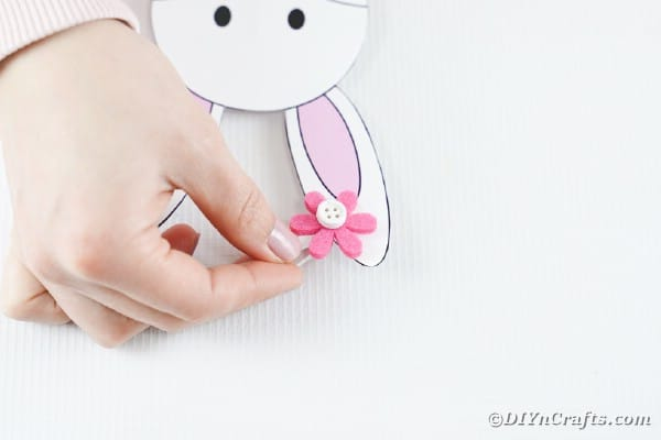 Gluing a flower to the bunny ear