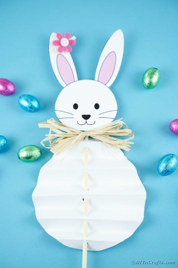 Paper Easter bunny on blue background