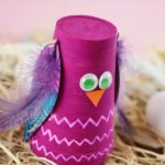 Plastic cup owl on hay