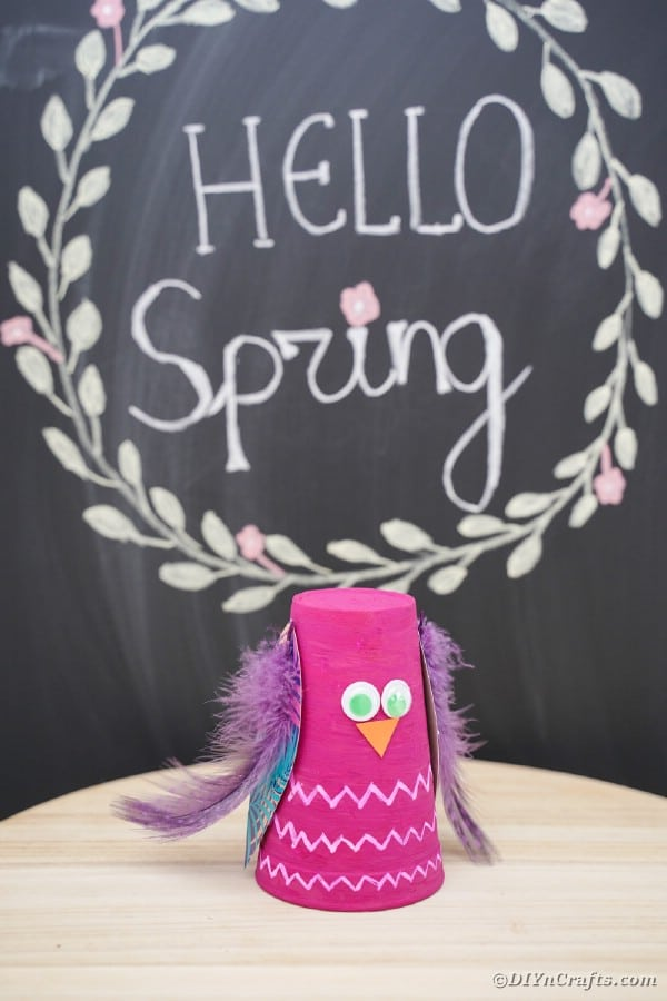 Plastic cup owl in front of chalkboard